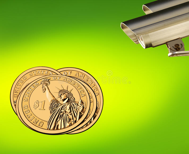 Gold US dollars in focus, business under control. Surveillance cameras & gold US dollars on yellow spotted green background. Concept of the keeping money