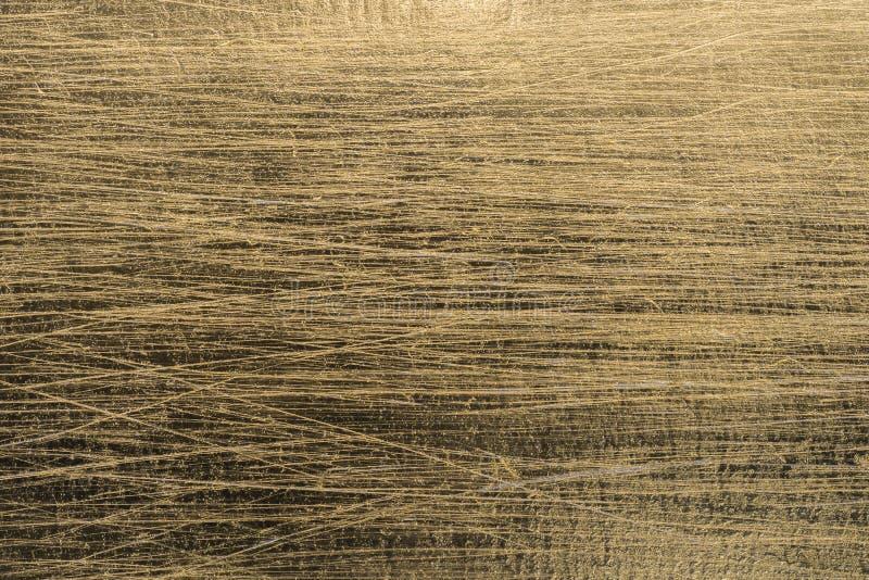 Gold verkratzte metallische Papierhintergrundbeschaffenheit stockbilder