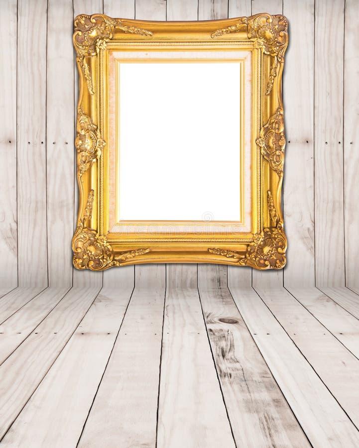 Gold vintage photo frame. On wood room stock image