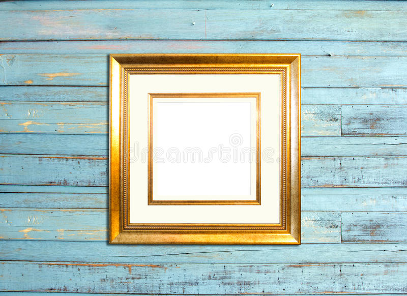 Gold Vintage picture frame on blue wood background royalty free stock photos