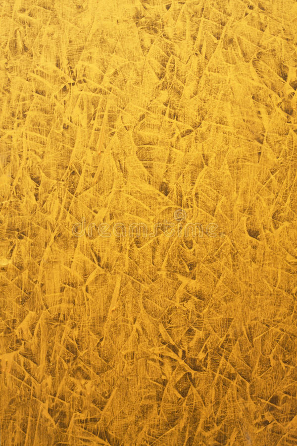 Gold wallpaper. Gold paint wallpaper for asia style royalty free stock images