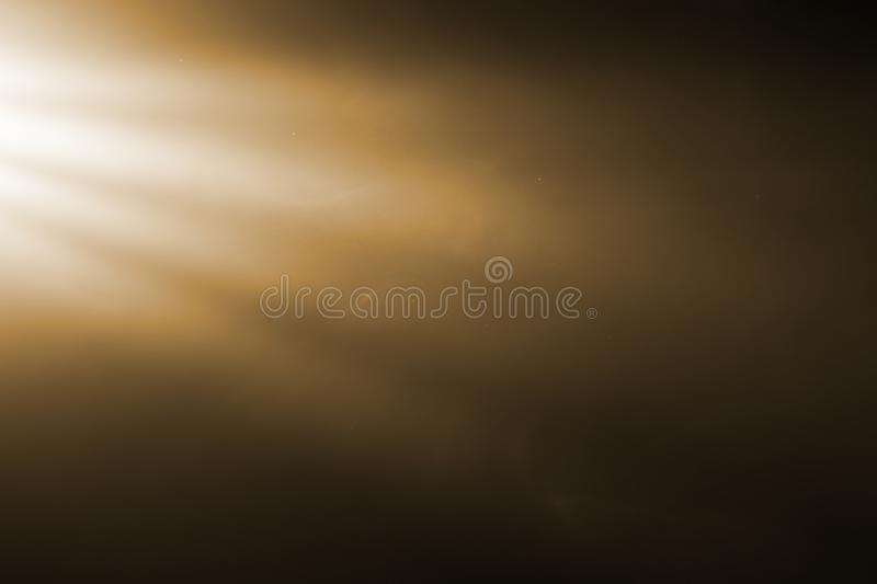 Gold warm color bright lens flare rays flashes leak for transitions on black background,movie titles and overlaying stock images