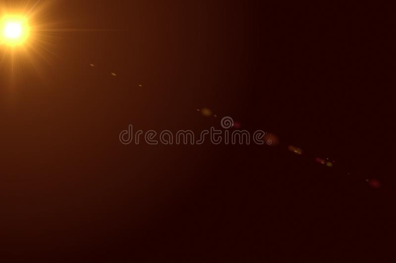 Gold warm color bright lens flare rays light flashes leak movement for transitions on black background,movie titles and overlaying stock image