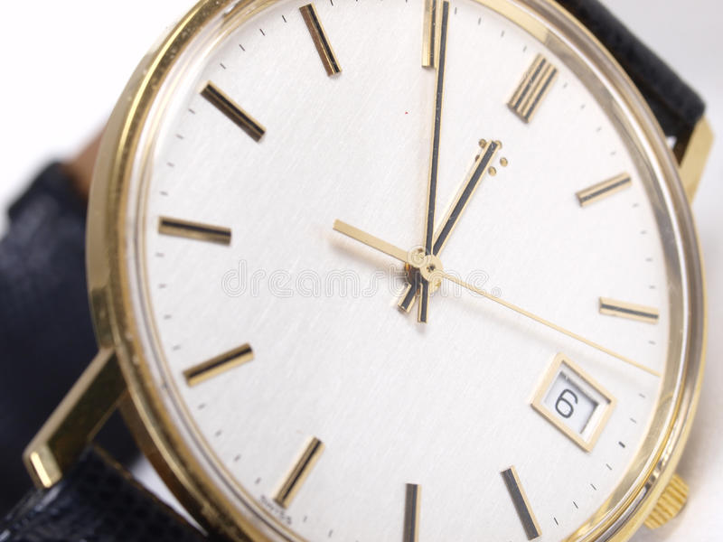 Gold watch. On white in studio royalty free stock photos