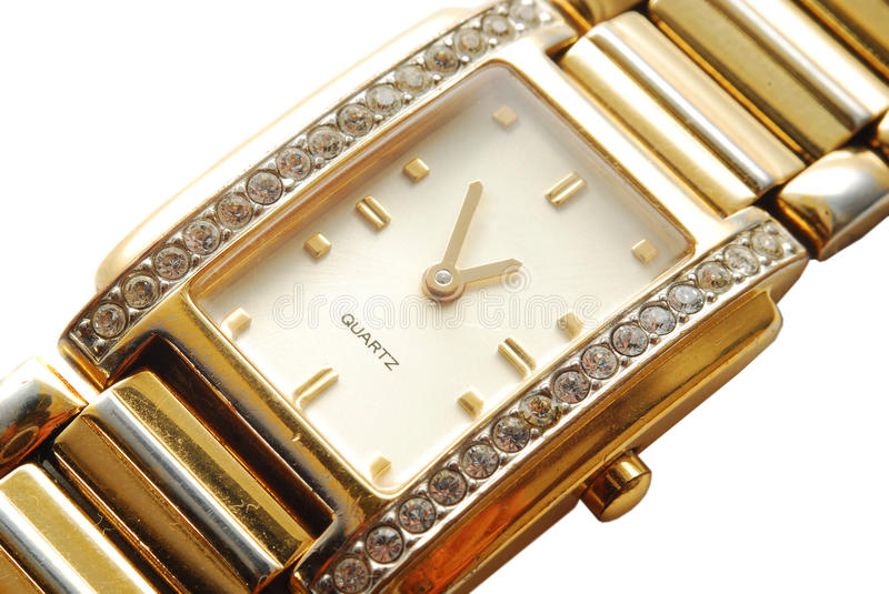 Gold watch. Detail of a gold watch with diamonds royalty free stock photos