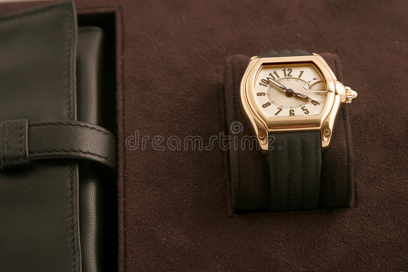 Gold watch with black strap stock photos