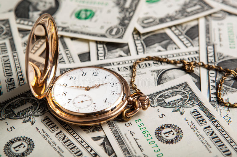Gold watch and dollar bills. Close up royalty free stock photo