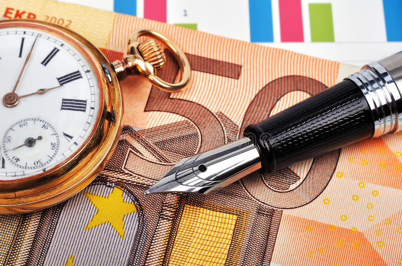 Gold watch and euro bills. Gold watch, ink pen and euro bills, close up royalty free stock photography