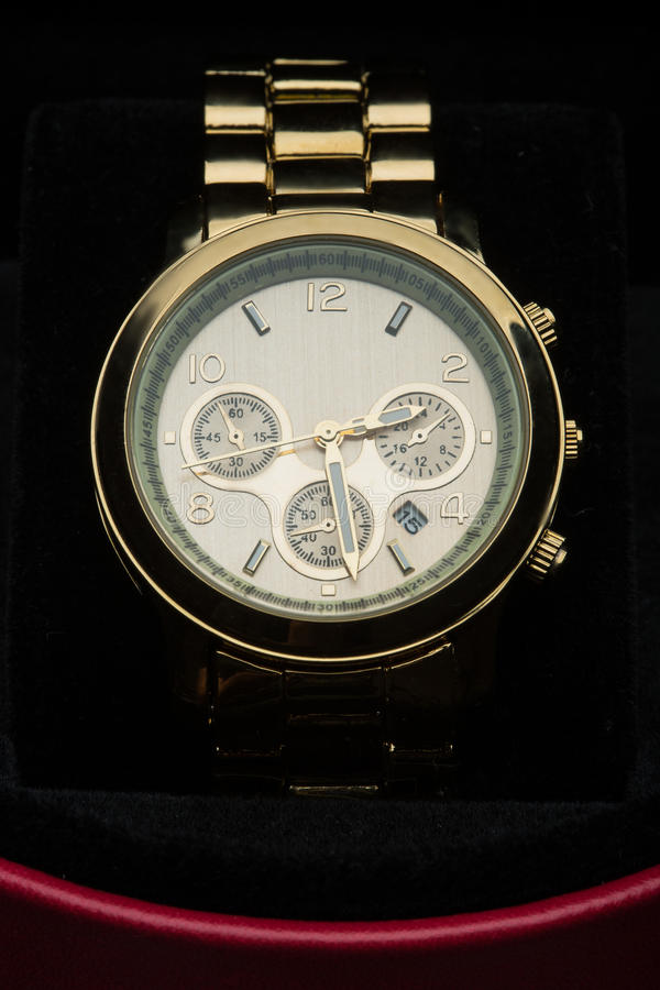Gold watch isolated on black background. Luxury gold watch isolated on black background royalty free stock images