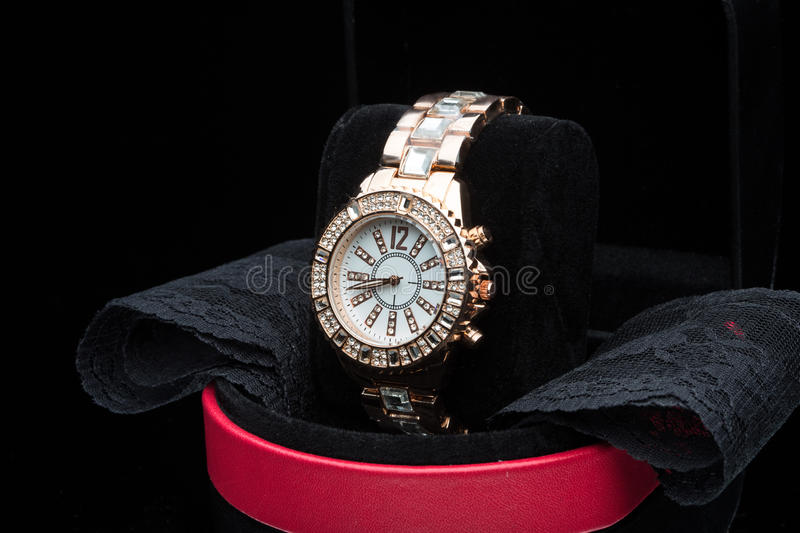 Gold watch isolated on black background. Luxury gold watch isolated on black background stock image
