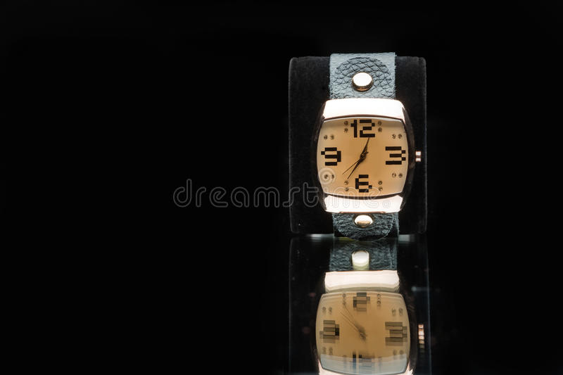 Gold watch isolated on black background. Luxury gold watch isolated on black background stock photo