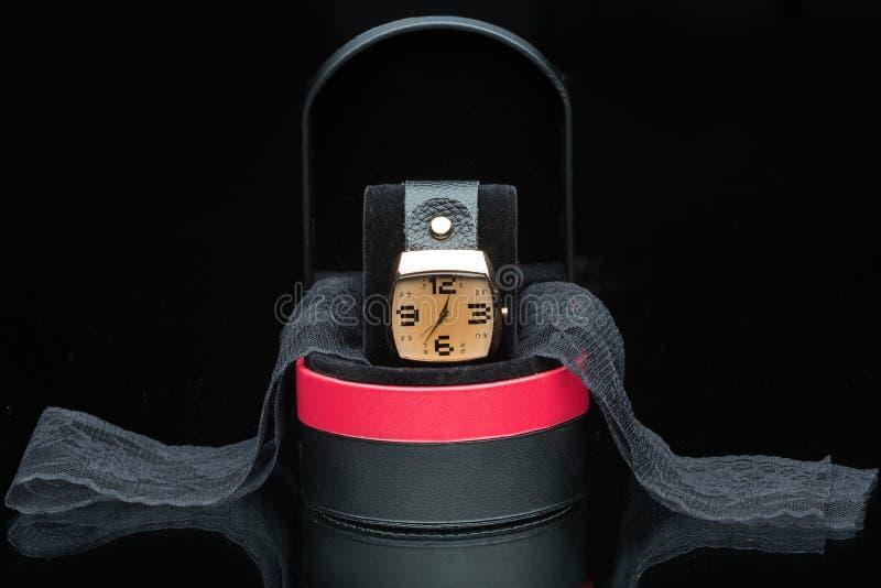 Gold watch isolated on black background. Luxury gold watch isolated on black background royalty free stock photo