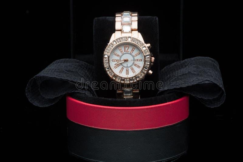 Gold watch isolated on black background. Luxury gold watch isolated on black background royalty free stock image