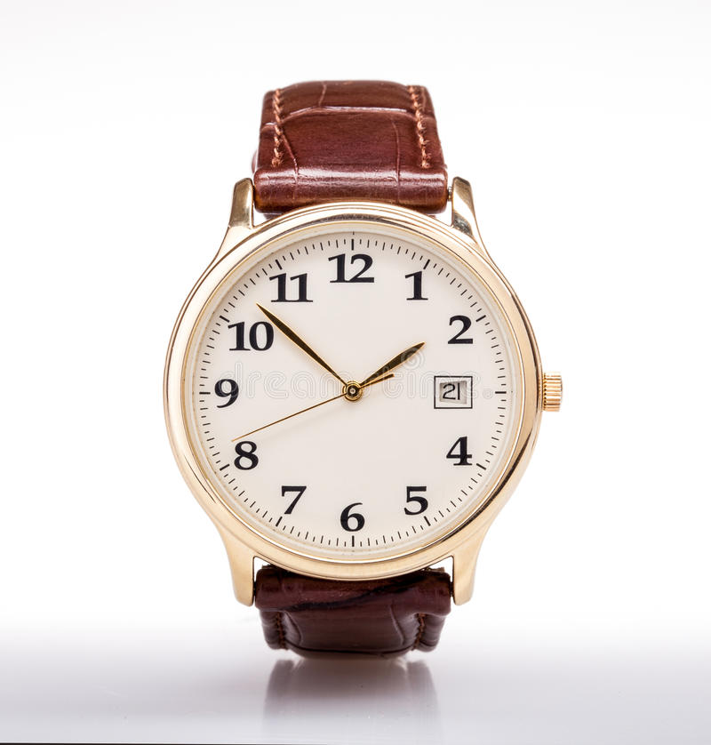 Gold watch leather strap. Gold watch with leather strap . Brown leather strap and white face royalty free stock images