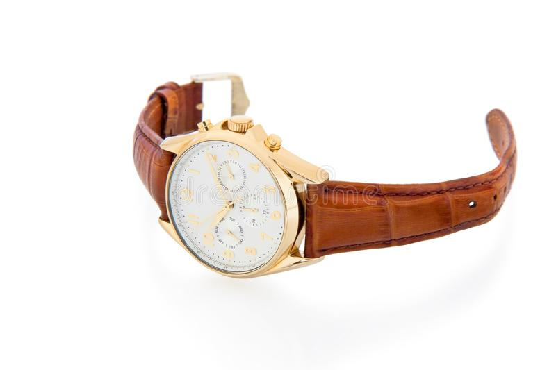 Gold watch with leather strap. Gold watch with leather brown strap on white background royalty free stock photo