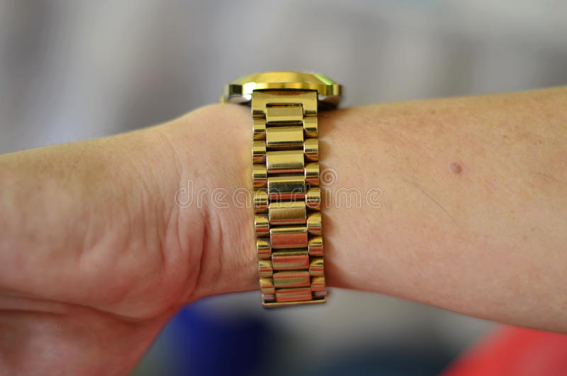Gold watch. Luxury expensive gold watch on your wrist stock photos