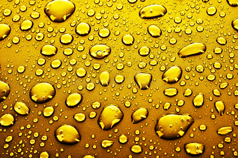Gold water drops. Many Gold water drops background stock photo