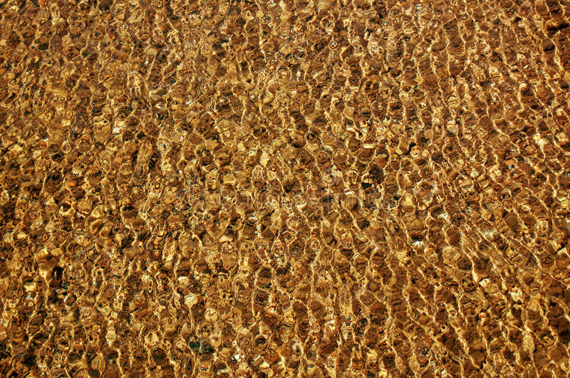 Gold water texture royalty free stock photos