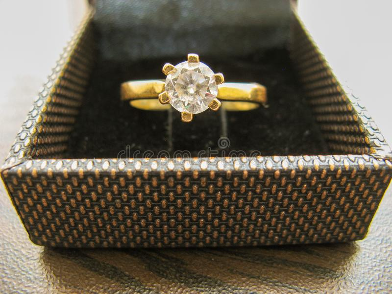 Gold wedding ring in box on closeup. Gold engagement ring.Gold Diamond ring . Women`s ring stock photography
