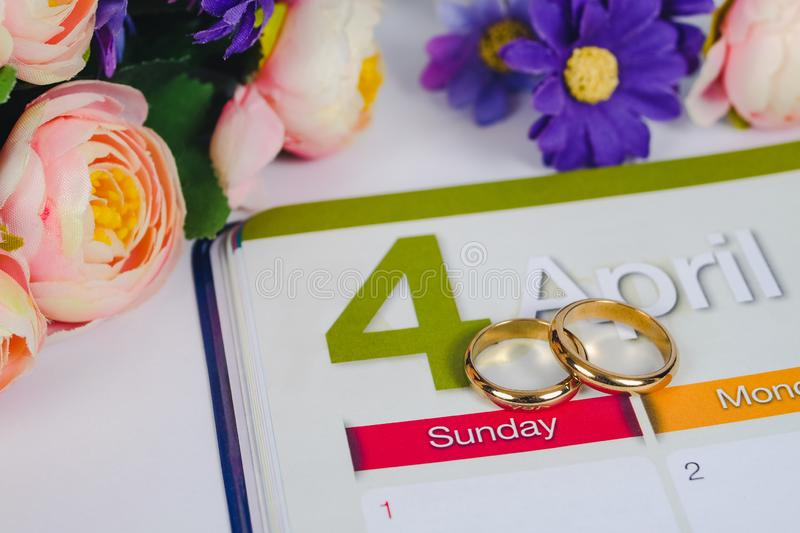 Gold Wedding ring on calendar planning or office tool royalty free stock images