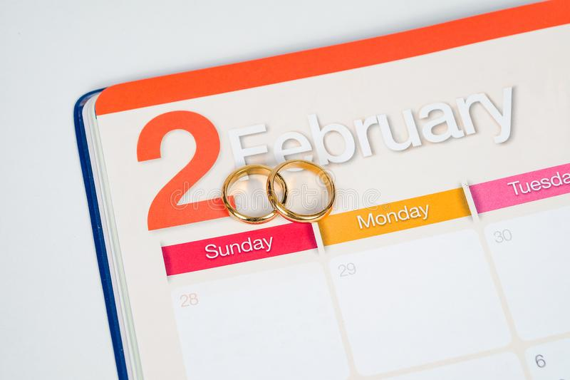 Gold Wedding ring on calendar planning or office tool stock images