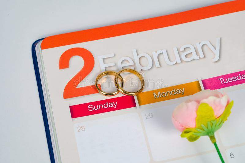 Gold Wedding ring on calendar planning or office stock photography