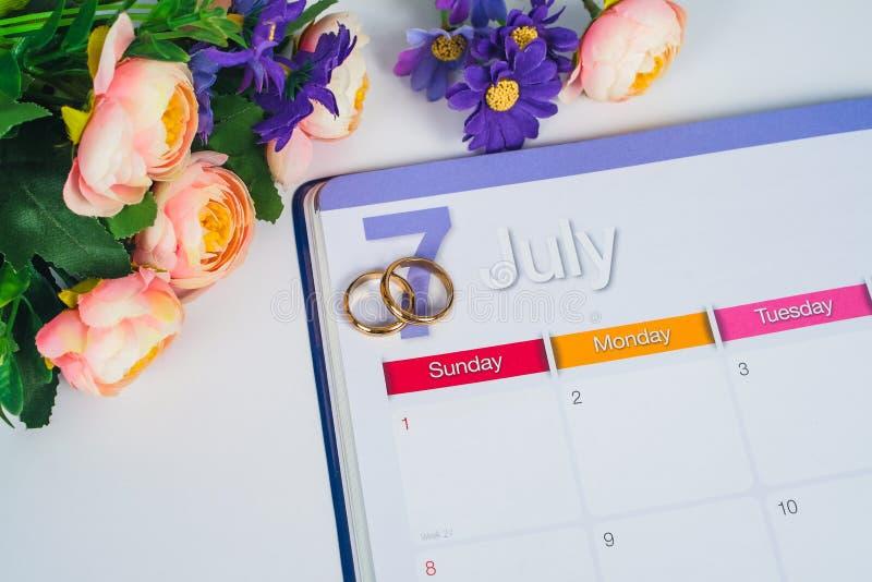 Gold Wedding ring on calendar planning stock image