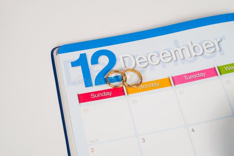 Gold Wedding ring on calendar planning royalty free stock photo