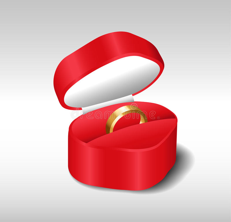 Gold wedding ring in a red box stock photography