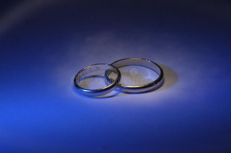 Gold wedding rings. Certificate and a symbol of marriage. Relationship. stock image
