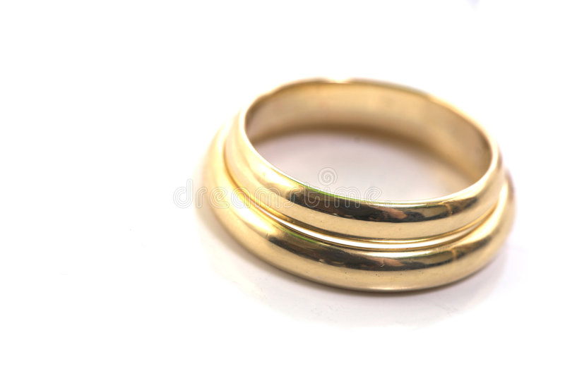 Gold wedding rings isolated on royalty free stock photography