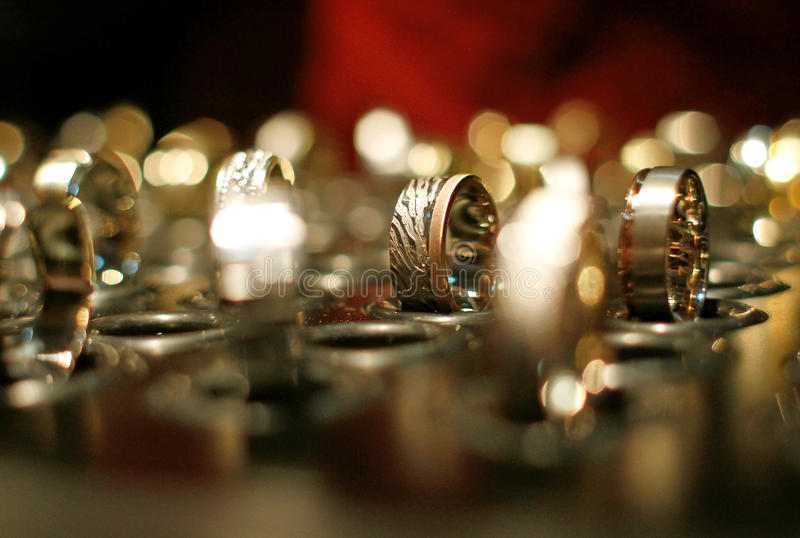 Gold wedding rings in jewelry shop stock photos