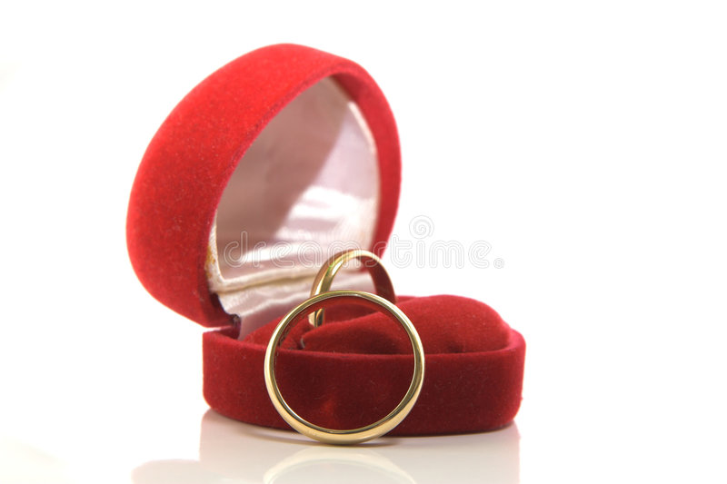 Gold wedding rings in red box royalty free stock photography