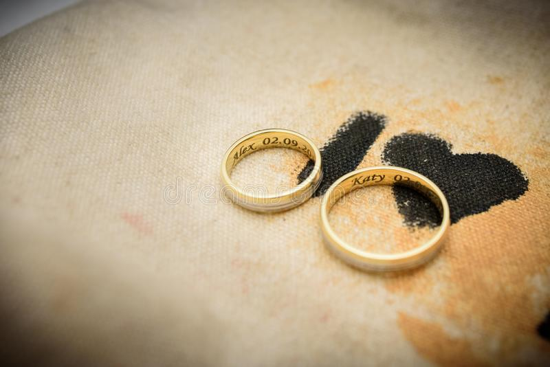 Gold wedding rings. Relationship, commitment, love royalty free stock photos