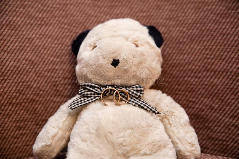 Wedding rings and teddy bear stock photography