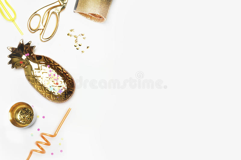 Gold woman items on table. Feminine scene, glamour style. White background mock up. Flat lay, party desk. Table view, workspace stock photography