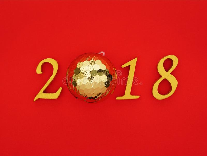 New year 2018. Gold wooden number 2018 on bright red background symbolizing an auspicious new year royalty free stock images