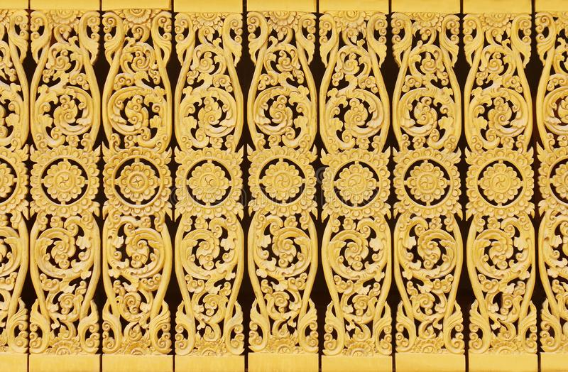 Gold wooden wall with flower patterns texture for background stock photos