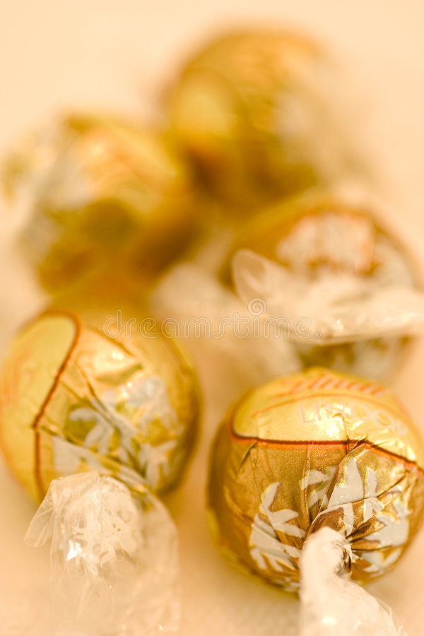 Gold wrap chocolate candy royalty free stock photo