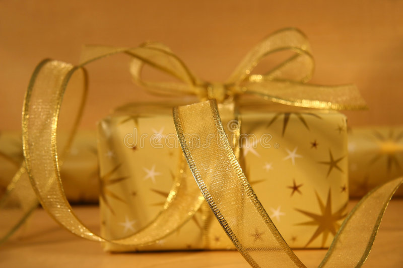 Gold wrappings. Gold wrapping paper and gift stock image