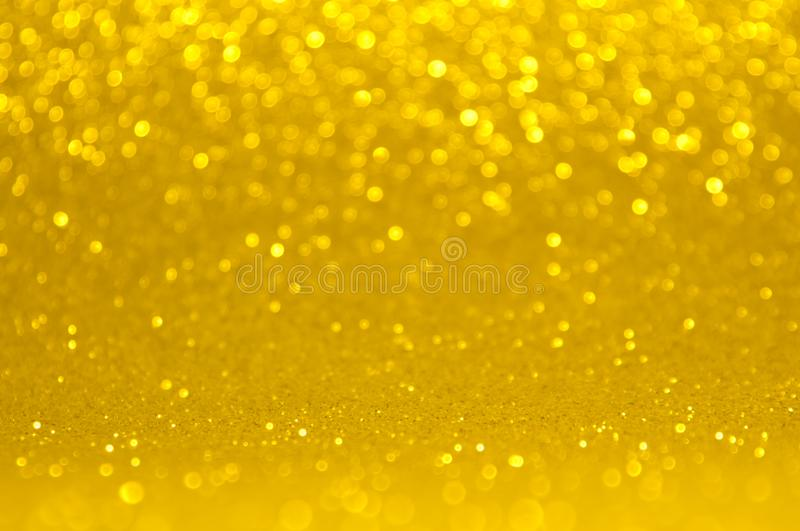 Gold, yellow abstract light background, Pink Gold shining lights, sparkling glittering Christmas lights.Season greeting background royalty free stock image