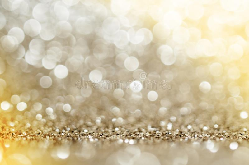 Gold, yellow,brown abstract light background, Golden shining lights, sparkling glittering Christmas lights. Blurred abstract holid stock photo