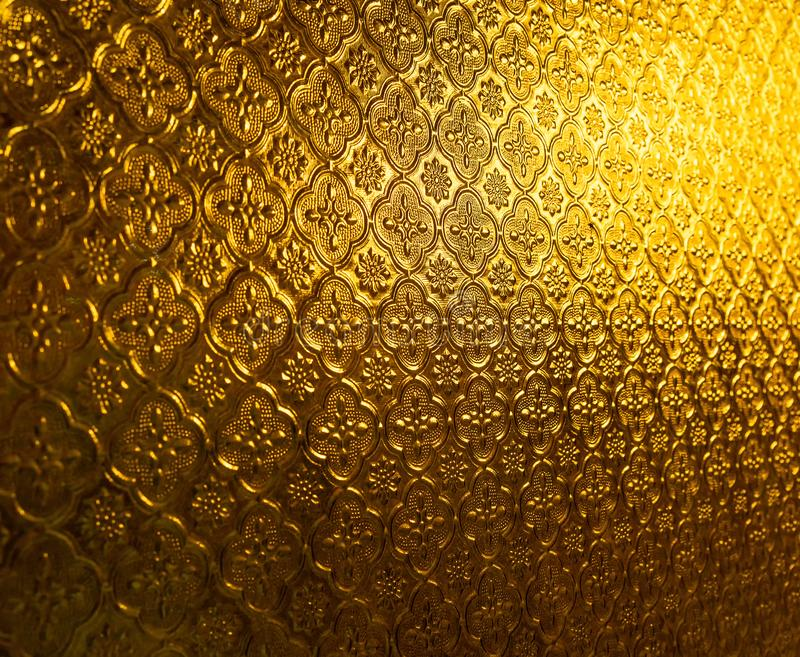 Gold yellow glass pattern on wall with lighting .Decoration for background and pattern concept.detailed design antique traditional royalty free stock photos