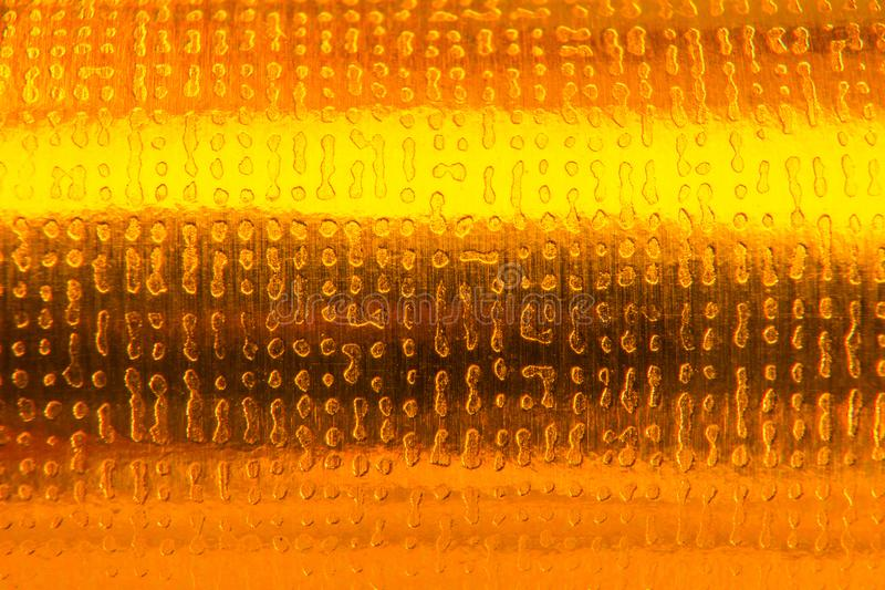 Goldabstrakte Hintergrundbeschaffenheit Geschenk-Papierverpackung lizenzfreie stockfotos