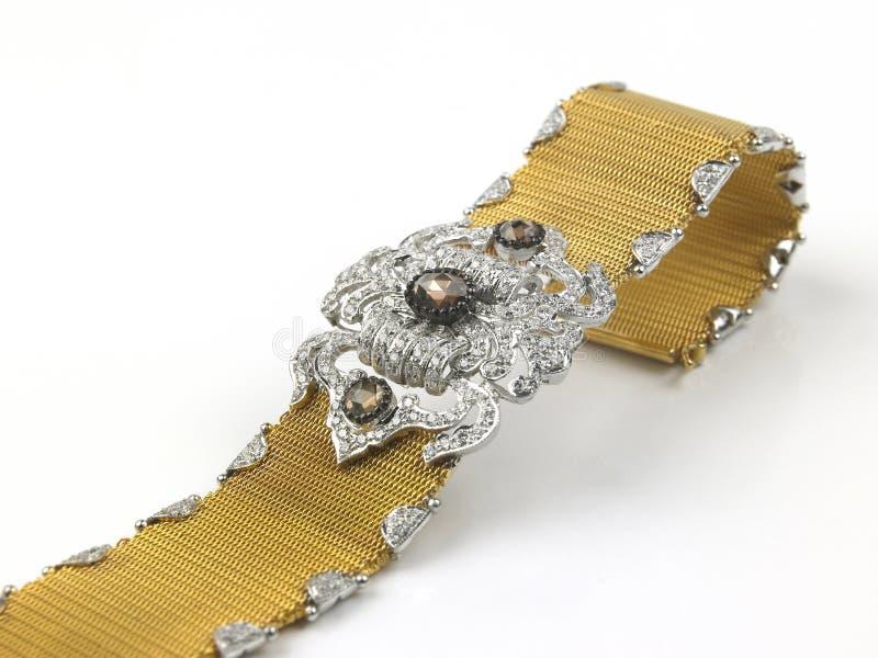 Goldarmband mit Diamanten lizenzfreie stockfotografie