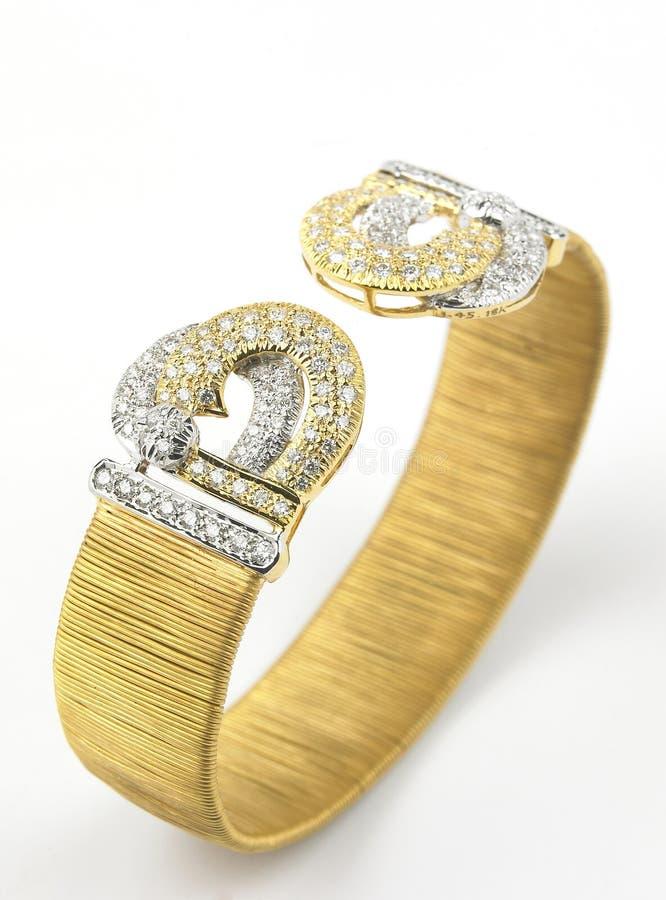 Goldarmband mit Diamanten stockfoto