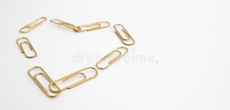 Goldbüroklammer-Herz stockfoto