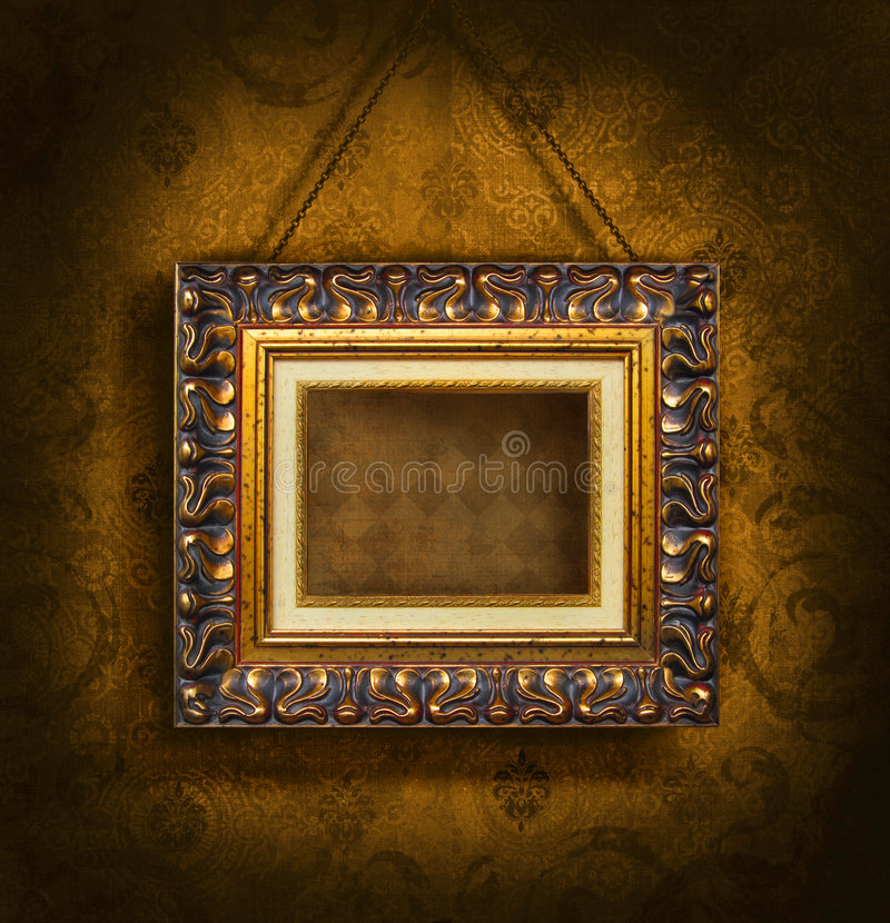 Goldbilderrahmen auf antiker Tapete lizenzfreie stockfotografie