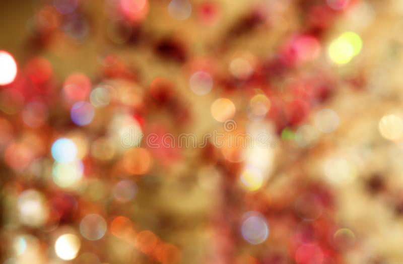 Golden abstract bokeh as background and graphic resources. Gold abstract background with bokeh defocused lights royalty free stock photo
