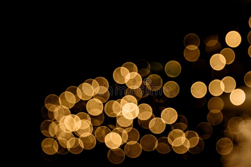 Abstract bokeh lights Christmas background for your design. Golden Abstract bokeh lights background. Festive concept. Place for design stock photos